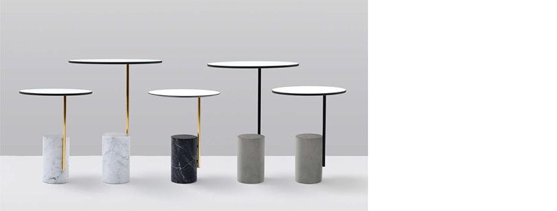 Las mesas auxiliares XA XA XA son un elemento decorativo, fácil y versátil, diseñado con una forma elegante y refinada. La base cilíndrica está realizada con mármol blanco de Carrara, negro Marquina, o de cemento soportando una estructura de metal. Las tapas redondas están disponibles en HPL o melamina blanca.