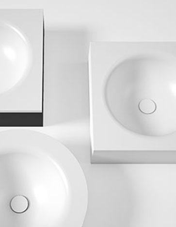 Innovadora línea de lavabos que combinan en su estructura vidrio templado y acero inoxidable lacado, ambos materiales disponibles en una amplia gama de color que convierten el baño en un entorno amable y colorido.